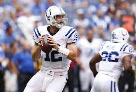 Andrew Luck About to Hoist a Football